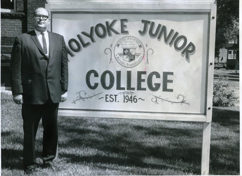 George Frost next to Holyoke Junior College sign.